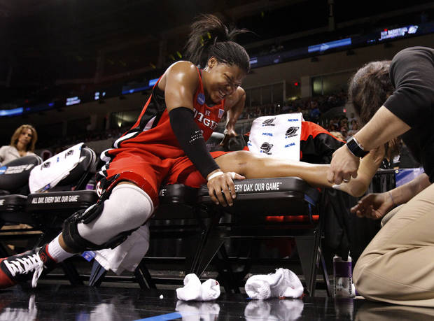 Rutgers' Khadijah Rushdan gets a quick fix for her injured ankle in the first half of the NCAA women's basketball tournament game between Rutgers and Purdue at the Ford Center in Oklahoma City, Okla. on Sunday, March 29, 2009.  She returned to action in the period.