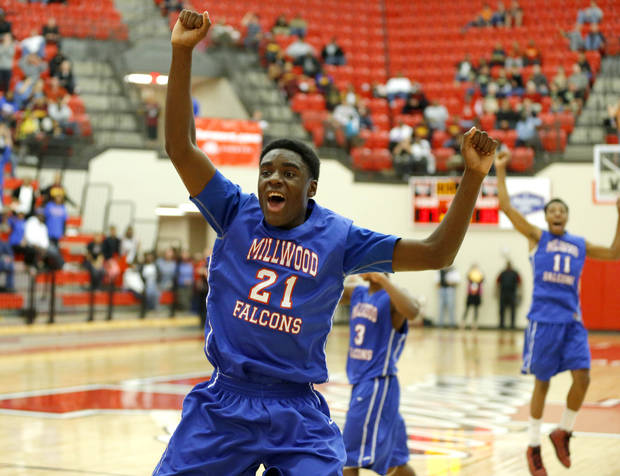 Millwood's Jamal Green-Gaskins celebrates Millwood's win in a Class 3A boys state basketball tournament game between Hugo and Millwood at Yukon High School in Yukon, Okla., Thursday, March 7, 2013. Photo by Bryan Terry, The Oklahoman