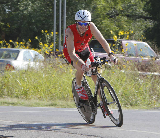 Gary Smith rounds a curve at Covell and McArthur during the Redman Triathlon in Oklahoma City, OK, Saturday, September 22, 2012,  By Paul Hellstern, The Oklahoman