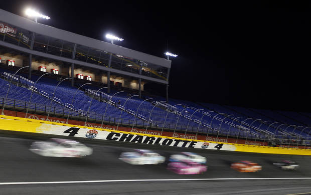 Drivers race out of Turn 4 during the NASCAR Dollar General 300 Nationwide Series auto race in Concord, N.C., Friday, Oct. 12, 2012. (AP Photo/Chuck Burton)