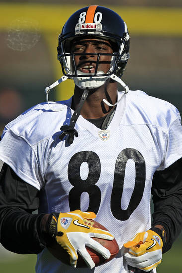 Newly signed Pittsburgh Steelers wide receiver Plaxico Burress (80) runs a drill during NFL football practice, Wednesday, Nov. 21, 2012, in Pittsburgh. Burress returned to the team that drafted him a dozen years ago on Wednesday hungry, humble and eager to prove there's still some life left in a career that's never quite lived up to his own outsized expectations. (AP Photo/Gene J. Puskar)