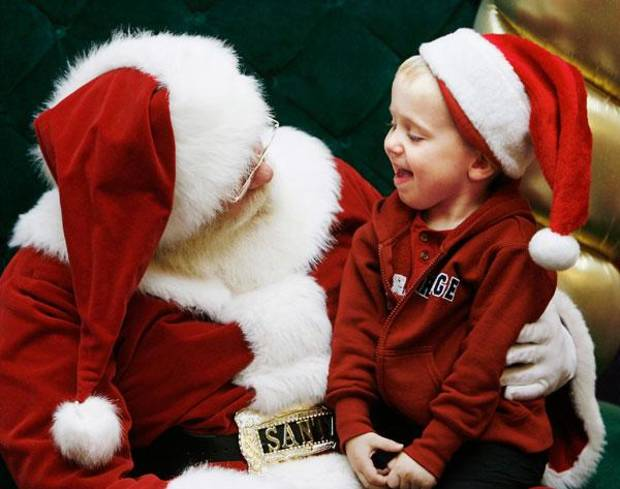 Andrew Sharp, 2, of Moore and Santa Claus enjoy a face to face chat  at Penn Square Mall Friday afternoon, Dec. 12, 2008. BY JIM BECKEL, THE OKLAHOMAN