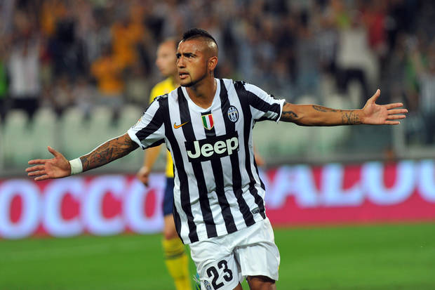 Juventus forward Arturo Vidal, of Chile, celebrates after scoring during a Serie A soccer match between Juventus and Lazio at the Juventus stadium, in Turin, Italy, Saturday,  Aug. 31, 2013. (AP Photo/Massimo Pinca)