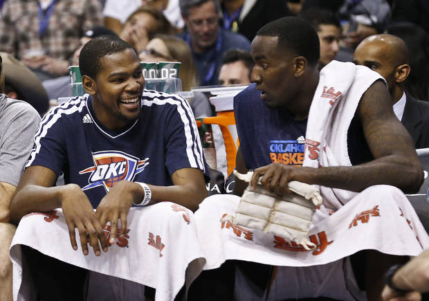 Oklahoma City Thunder's Kevin Durant, left, laughs as he talks with Kendrick Perkins during the second half in an NBA basketball game against the Phoenix Suns, Sunday, Feb. 10, 2013, in Phoenix. The Thunder won 97-69. (AP Photo/Ross D. Franklin) ORG XMIT: PNU113