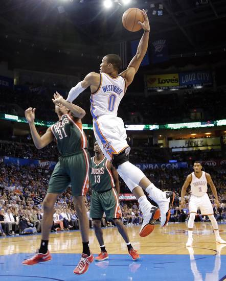 Oklahoma City's Russell Westbrook (0) drives to the basket past Milwaukee 's John Henson (31) during the season finally NBA basketball game between the Oklahoma City Thunder and the Milwaukee Bucks at Chesapeake Energy Arena on Wednesday, April 17, 2013, in Oklahoma City, Okla.   Photo by Chris Landsberger, The Oklahoman