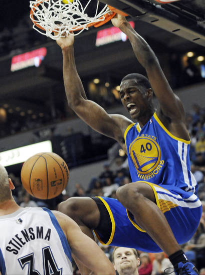 Golden State Warriors' Harrison Barnes dunks in the second half of an NBA basketball game against the Minnesota Timberwolves, Friday, Nov. 16, 2012, in Minneapolis. The Warriors won 106-98. Barnes and David Lee each scored game highs of 18 points. (AP Photo/Jim Mone)