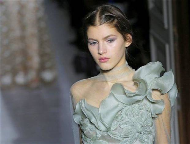A model wears a creation by fashion designers Maria Grazia Chiuri and Pier Paolo Piccioli for Valentino as part of the Women's Spring/Summer 2013 Haute Couture fashion collection presented in Paris, Wednesday, Jan. 23 2013 (AP Photo/ Jacques Brinon)
