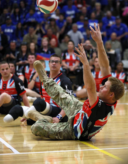 Britain's Prince Harry plays sitting volleyball with the United Kingdom team at a visit to the Warrior Games opening, Saturday, May 11, 2013 in Colorado Springs, Colo.  The Warrior Games is a Paralympic-style competition featuring injured servicemen and women from the U.S., United Kingdom, Canada and Australia. (AP Photo/Rick Wilking, Pool)