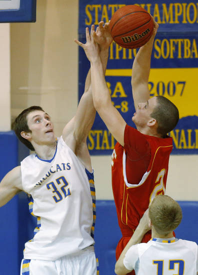Bethel's Trevor Stark blocks the shot of Dale's Caleb Banks during their boys high school basketball game at Bethel High School in Shawnee, Okla., Friday, Feb. 1, 2013. Photo by Bryan Terry, The Oklahoman