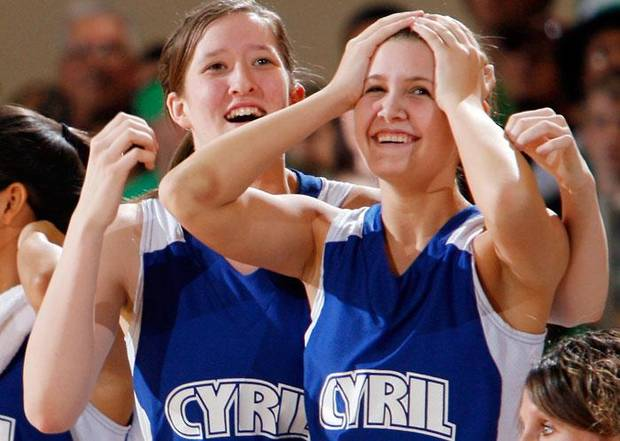 Cyril's Emily Horn and Chelsea Reynolds (20) react to the overtime win against Lomega during the semifinals of the Class B girls Oklahoma State Basketball Championships at the State Fair Arena on Friday, March 6, 2009, in Oklahoma City, Okla.  PHOTO BY CHRIS LANDSBERGER, THE OKLAHOMAN