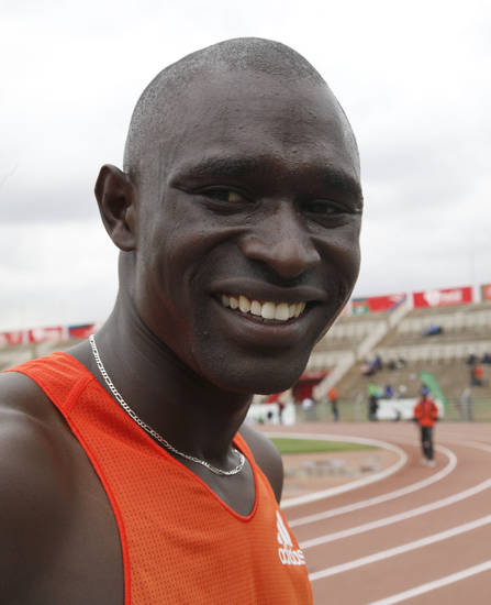 David Lekuta Rudisha of Kenya reacts after winning the men's 800 meters semifinal during the National Trials for the London 2012 Olympic Games at Nyayo National Stadium, Nairobi, Kenya, Thursday, June 21, 2012. (AP Photo/Sayyid Azim)