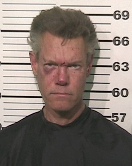 FILE - This file photo provided by the Grayson County, Texas, Sheriff�s Office shows Country singer Randy Travis. A prosecutor says the country music star is expected to enter a guilty plea in a drunken-driving case in North Texas. (AP Photo/Grayson County Sheriff's Office)