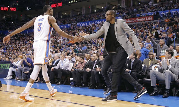 Kevin Durant, right, slaps hands with Perry Jones during OKC�s 95-89 loss to the Bucks on Wednesday. Photo by Chris Landsberger, The Oklahoman