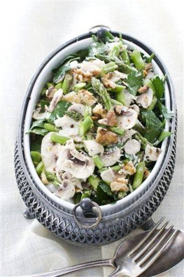 In this image taken on March 11, 2013, a raw asparagus, mushroom and parsley salad with nuts is shown in Concord, N.H. (AP Photo/Matthew Mead)