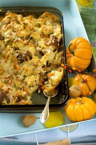 In this image taken on Oct. 2, 2012, Cheesy Stuffing for a Thanksgiving Day family dinner is shown in Concord, N.H. (AP Photo/Matthew Mead)
