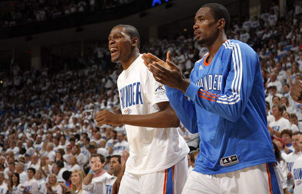 Oklahoma City's Kevin Durant (35) and Serge Ibaka (9) celebrate during game five of the Western Conference semifinals between the Memphis Grizzlies and the Oklahoma City Thunder in the NBA basketball playoffs at Oklahoma City Arena in Oklahoma City, Wednesday, May 11, 2011. Photo by Sarah Phipps, The Oklahoman