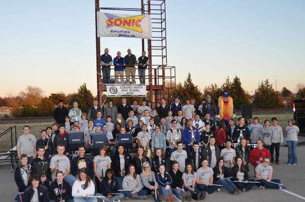 The Edmond North High School Band is pictured in front of the new Sonic Director�s Tower with band director Robert Hullet, Sonic representatives Dane Martin and Brandon Taylor, and Bill Towler, North Band Booster representative.