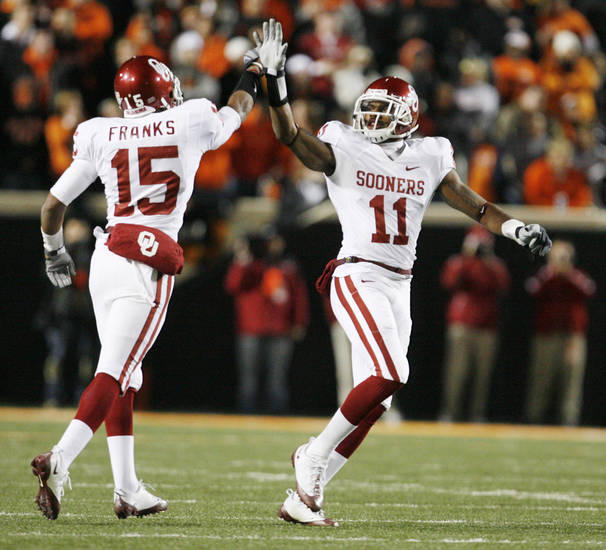 Dominique Franks and Lendy Holmes high five after an interception by Franks in the first quarter of the college football game between the University of Oklahoma Sooners (OU) and Oklahoma State University Cowboys (OSU) at Boone Pickens Stadium on Saturday, Nov. 29, 2008, in Stillwater, Okla. STAFF PHOTO BY NATE BILLINGS