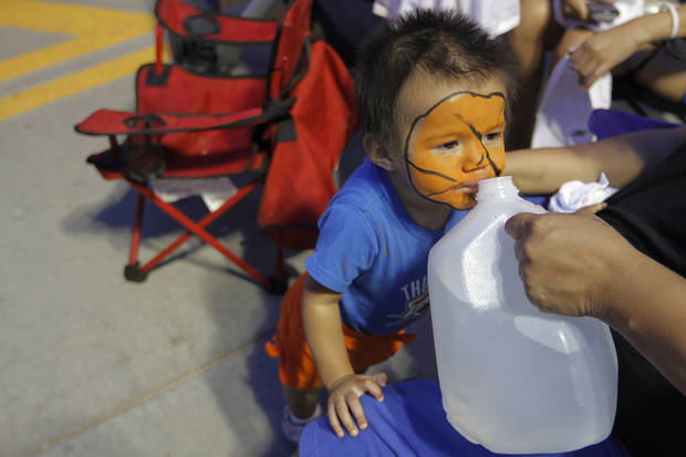 Priscilla Martinez, 1, of Oklahoma City, takes a drink of water at Love's Thunder Alley, Monday, April 30, 2012.  Photo by Garett Fisbeck, For The Oklahoman