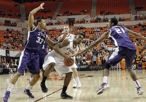 Oklahoma State's Le'Bryan Nash (2) drives between TCU's Garlon Green (33) and Nate Butler Lind (21) during the college basketball game between Oklahoma State University Cowboys (OSU) and Texas Christian University Horned Frogs (TCU) at Gallagher-Iba Arena on Wednesday Jan. 9, 2013, in Stillwater, Okla. 