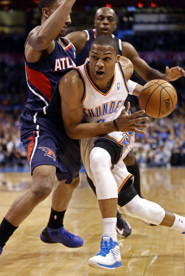 Oklahoma City Thunder's Russell Westbrook (0) drives past Atlanta Hawk's Jeff Teague (0) as the Oklahoma City Thunder play the Atlanta Hawks in NBA basketball at the Chesapeake Energy Arena in Oklahoma City, on Sunday, Nov. 4, 2012.  Photo by Steve Sisney, The Oklahoman