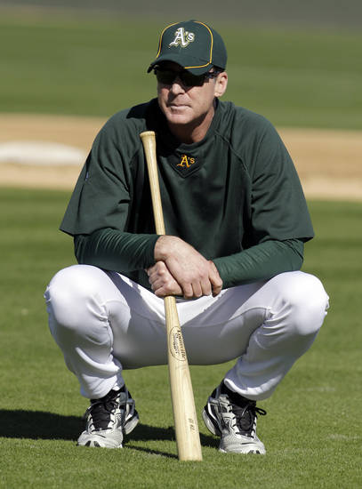 FILE - In this Feb. 27, 2012, file photo, Oakland Athletics manager Bob Melvin during a spring training baseball workout in Phoenix. Melvin was voted as the American League Manager of the Year on Tuesday, Nov. 13, 2012. (AP Photo/Darron Cummings, File)