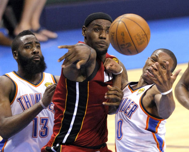 Oklahoma City's Russell Westbrook (0) and James Harden (13) fight Miami's LeBron James (6) for rebound during Game 1 of the NBA Finals between the Oklahoma City Thunder and the Miami Heat at Chesapeake Energy Arena in Oklahoma City, Tuesday, June 12, 2012. Photo by Sarah Phipps, The Oklahoman