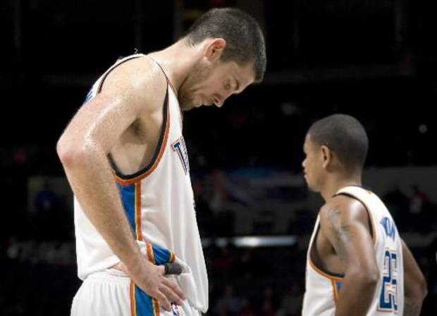 Oklahoma City's  Nick  Collison, left, and Earl Watson react during a timeout during the NBA basketball game between the Oklahoma City Thunder and the Los Angeles Clippers at the Ford Center in Oklahoma City, Tuesday, Dec. 16, 2008. PHOTO BY SARAH PHIPPS, THE OKLAHOMAN