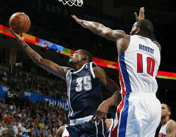 Oklahoma City's Kevin Durant (35) takes the ball past Detroit's Greg Monroe (10) during an NBA basketball game between the Detroit Pistons and the Oklahoma City Thunder at the Chesapeake Energy Arena in Oklahoma City, Friday, Nov. 9, 2012. Oklahoma City won, 105-94. Photo by Nate Billings, The Oklahoman