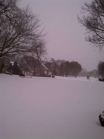 This is the snowstorm's effect in one east Edmond neighborhood and its streets.