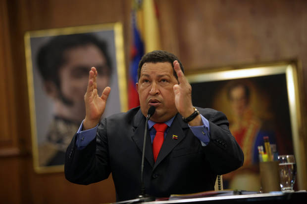 Venezuela's President Hugo Chavez talks during a press conference at the Miraflores palace in Caracas, Venezuela, Tuesday, Oct. 9, 2012. The 58-year-old former military officer Chavez won his fourth consecutive presidential bid Sunday and shows no signs of ballot fatigue. (AP Photo/Rodrigo Abd)