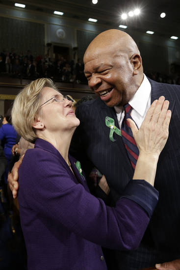 Sen. Elizabeth Warren, D-Mass., talks with Rep. Elijah Cummings, D-Md. on Capitol Hill in Washington, Tuesday, Feb. 12, 2013, before President Barack Obama's State of the Union address during a joint session of Congress. (AP Photo/Charles Dharapak Pool) ORG XMIT: CAP502