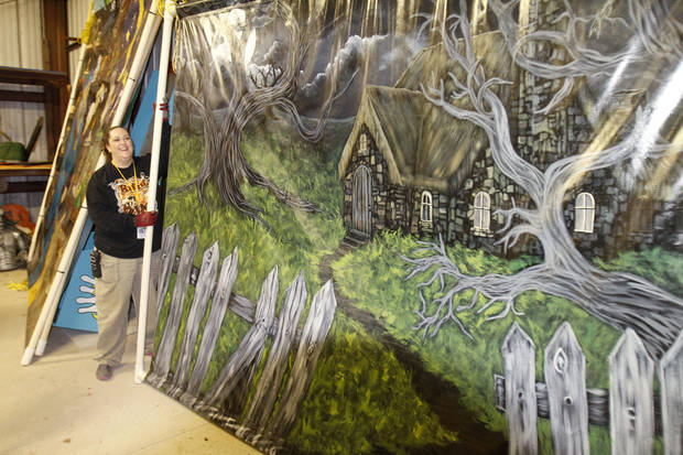 Graphic designer Megan Watham brings a large painted display out of storage in preparation for Haunt the Zoo, which begins Friday at the Oklahoma City Zoo. Photo by Paul Hellstern, The Oklahoman <strong>PAUL HELLSTERN</strong>