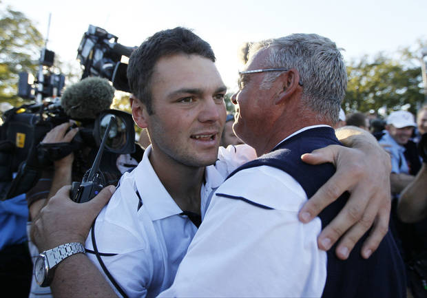 Europe's Martin Kaymer celebrates with Darren Clarke after winning the Ryder Cup PGA golf tournament Sunday, Sept. 30, 2012, at the Medinah Country Club in Medinah, Ill. (AP Photo/Charles Rex Arbogast)  ORG XMIT: PGA207
