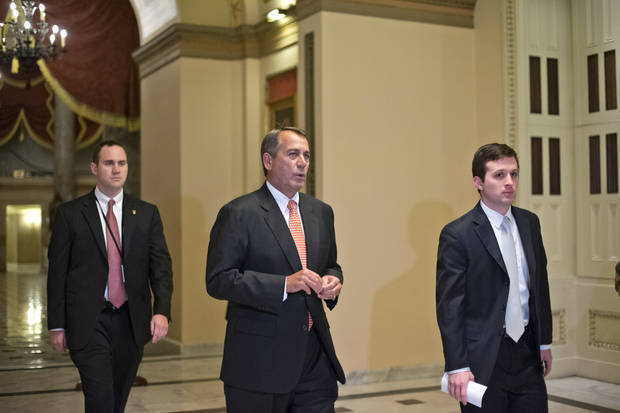 "Speaker of the House John Boehner, R-Ohio, walks to the House floor during a vote at the Capitol in Washington, Wednesday evening, Dec. 12, 2012. Boehner and the other House Republican leaders are calling for Obama to come up with plan they can accept for spending cuts and tax revenue to avoid the so-called ""fiscal cliff"" of automatic tax hikes and budget reductions. (AP Photo/J. Scott Applewhite)"