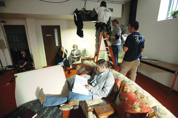 "Actor Mike Vogel, who portrays Brooks Douglass, looks at his script during a break on the set of the feature film ""Heaven's Rain"" at First Baptist Church, 1201 N Robinson. Photo by Steve Gooch, The Oklahoman"