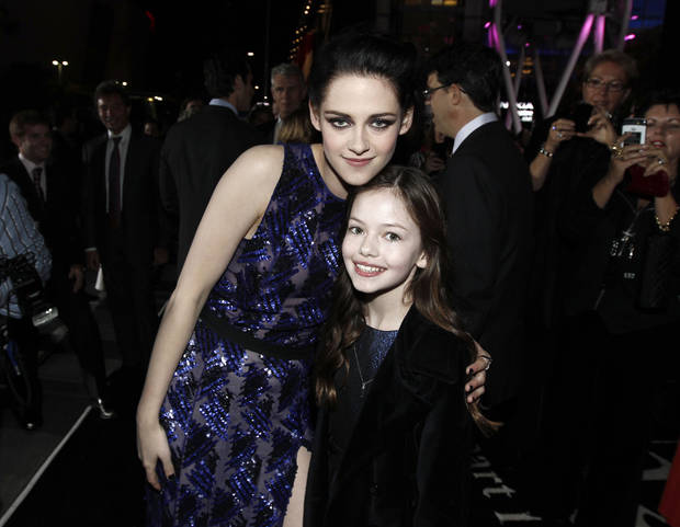 "Kristen Stewart, left, and Mackenzie Foy arrive at the world premiere of ""The Twilight Saga: Breaking Dawn - Part 1"" on Monday, Nov. 14, 2011, in Los Angeles. (AP Photo/Matt Sayles) ORG XMIT: CASH197"