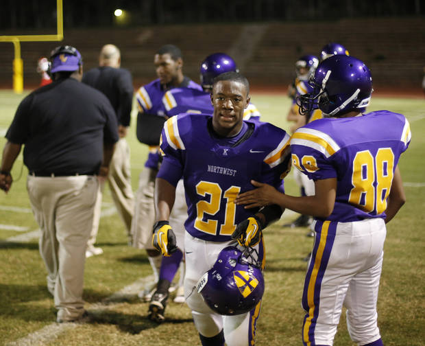 NWC RB Lorenzo Alexander is congratulated after one of his four touchdowns at the Northwest Classen vs. Western Heights high school football game at Taft Stadium Thursday, September 20, 2012. Photo by Doug Hoke, The Oklahoman
