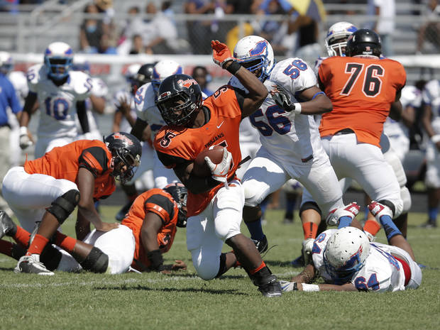 Douglass's Chavez Wyatt (5) runs the ball during a high school football game between Douglass and Millwood in Oklahoma City, Saturday, Sept. 8, 2012.  Photo by Garett Fisbeck, The Oklahoman