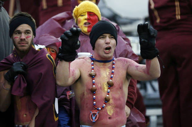 Louisiana-Monroe fans brave the cold winds to cheer for their team against Ohio in the Independence Bowl NCAA college football game in Shreveport, La., Friday, Dec. 28, 2012. Ohio won 45-14. (AP Photo/Rogelio V. Solis)
