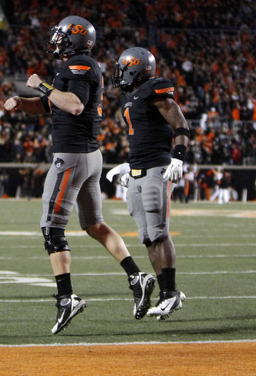 Oklahoma State's Brandon Weeden (3) and Joseph Randle (1) celebrate Randle's game winning touchdown during a college football game between the Oklahoma State University Cowboys (OSU) and the Kansas State University Wildcats (KSU) at Boone Pickens Stadium in Stillwater, Okla., Saturday, Nov. 5, 2011.  Photo by Sarah Phipps, The Oklahoman