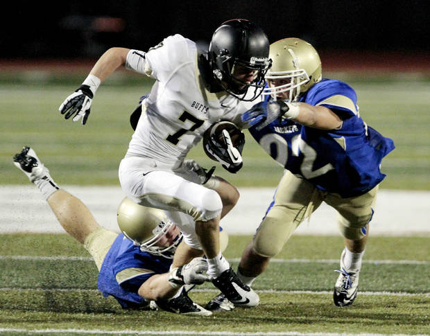 Derrick Briggs , left, and an unidentified Choctaw player try to bring down McAlester's Caden Pratt (7) during a high school football scrimmage at Harve Collins Field at Norman High School on Friday, Aug. 24, 2012, in Norman, Okla.  Photo by Steve Sisney, The Oklahoman