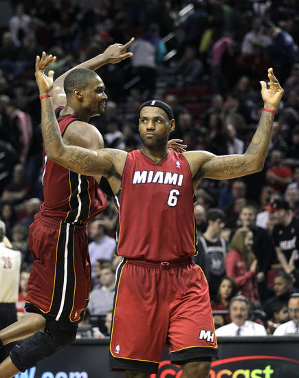 Miami Heat's LeBron James (6) and teammate Chris Bosh celebrate their victory over the Portland Trail Blazers during an NBA basketball game Sunday, Jan. 9, 2011, in Portland, Ore. The Heat defeated the Trail Blazers 107-100.  (AP Photo/Rick Bowmer) ORG XMIT: ORRB108