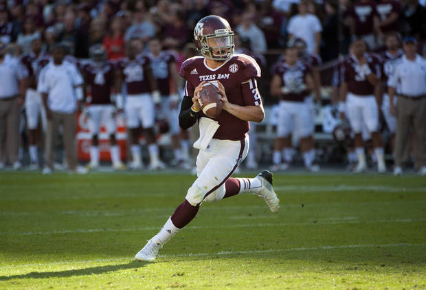FILE - In this Nov. 17, 2012, file photo, Texas A&M's Johnny Manziel rolls out to throw a touchdown pass during the first quarter of an NCAA college football game against Sam Houston State in College Station, Texas. Manziel could become the first freshman to win the Heisman Trophy when the award is presented on Saturday night. (AP Photo/Dave Einsel, File) ORG XMIT: NY155
