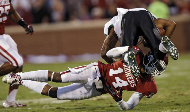 Oklahoma's Aaron Colvin (14) brings down Baylor's Darryl Stonum (7) during the college football game between the University of Oklahoma Sooners (OU) and Baylor University Bears (BU) at Gaylord Family - Oklahoma Memorial Stadium on Saturday, Nov. 10, 2012, in Norman, Okla.  Photo by Chris Landsberger, The Oklahoman