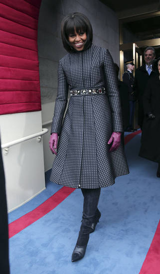 First lady Micehlle Obama arrives on the West Front of the Capitol in Washington, Monday, Jan. 21, 2013, for the Presidential Barack Obama's ceremonial swearing-in ceremony during the 57th Presidential Inauguration.  (AP Photo/Win McNamee, Pool)