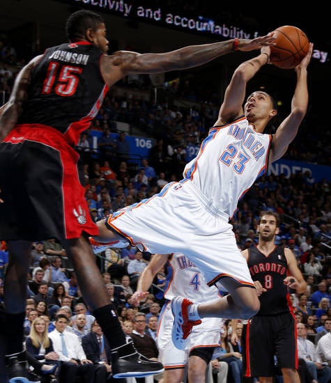 Oklahoma City's Kevin Martin (23) shoots the ball beside Toronto's Amir Johnson (15) during an NBA basketball game between the Oklahoma City Thunder and the Toronto Raptors at Chesapeake Energy Arena in Oklahoma City, Tuesday, Nov. 6, 2012.  Tuesday, Nov. 6, 2012. Oklahoma City won 108-88. Photo by Bryan Terry, The Oklahoman