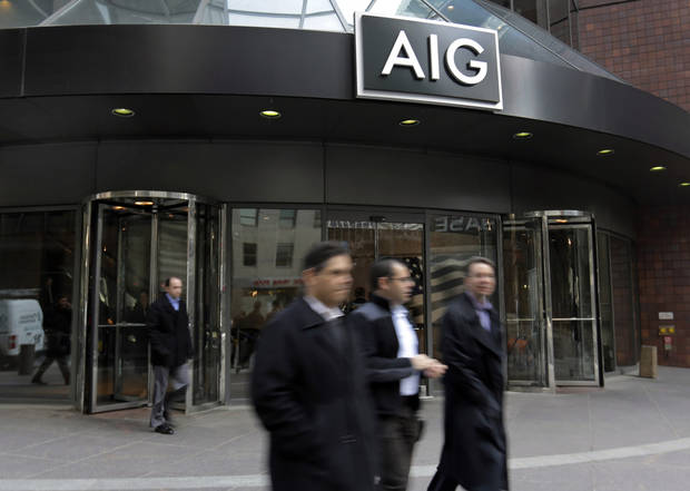 People pass the AIG building, in New York, Tuesday, Jan. 8, 2013. American International Group Inc. said Tuesday its board of directors will weigh whether to take part in a shareholder lawsuit against the U.S. over the government's $182 billion bailout of the insurer. (AP Photo/Richard Drew)