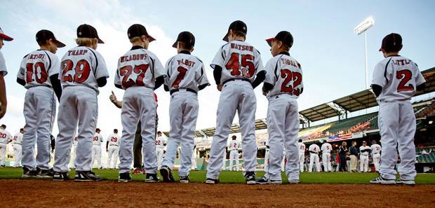 Members of the Oklahoma Rangers baseball team from Yukon get ready to take the field with the RedHawks prior to the Oklahoma City RedHawks home opener against the Memphis Redbirds at the Bricktown Ballpark in Oklahoma City, Friday, April 17, 2009. Photo by Bryan Terry, The Oklahoman