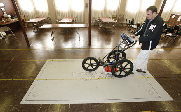 Scott Hammerstedt with the Oklahoma Archeological Survey at the University of Oklahoma uses ground-penetrating radar Wednesday to look inside the structure containing a time capsule at First Lutheran Church of Oklahoma City, 1300 N Robinson. PHOTO BY STEVE GOOCH, THE OKLAHOMAN